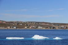 In the hamlet of 1,100 people nestled below the mountains in Clyde River, residents have been fighting seismic blasting in their hunting grounds of Baffin Bay. (Photo: Chris Williams)