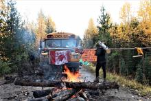 A roadblock preventing Coastal GasLink from accessing a site where it plans to drill under the Morice River, or Wedzin Kwa to the Wet'suwet'en. RCMP have visited the site several times since the camp was created on Sept. 24, making two arrests. Photo by Amanda Follett Hosgood.