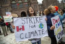 Students walked out of school to gather on the south lawn of Queens Park in Toronto to rally for climate change on March 15, 2019. Photo by Carlos Osorio