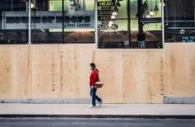 A man walks down an empty Yonge Street in Toronto. Photo by Myles Herod/Instagram.