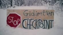 A sign for a blockade check point by the Gidimt'en clan of the Wet'suwet'en First Nation is shown in this undated handout photo posted on the Wet'suwet'en Access Point on Gidumt'en Territory Facebook page.