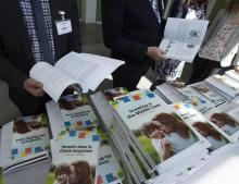 People sift through the 2019 budget booklet at a lockup session with experts and reporters in Ottawa on March 19, 2019. File photo by The Canadian Press/Fred Chartrand
