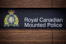 "The RCMP logo is seen outside Royal Canadian Mounted Police ""E"" Division Headquarters, in Surrey, B.C., on Friday, April 13, 2018. File photo by The Canadian Press/Darryl Dyck"