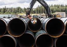 FILE: Pipe for the Trans Mountain pipeline are unloaded in Edson, Alta. on June 18, 2019. THE CANADIAN PRESS/Jason Franson