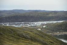 The community of Apex, Nvt., is seen from Iqaluit on Friday, Aug. 2, 2019. File photo by The Canadian Press/Sean Kilpatrick