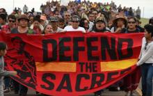 Native Americans march to a burial ground sacred site that was disturbed by bulldozers building the Dakota Access Pipeline. Photo: AFP