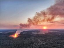 Main image: Screen shot from drone video of the fracked gas well blowout, at a well operated by GEP Haynesville, LLC, in Red River Parish, Louisiana. Credit: Phin Percy Jr., used with permission