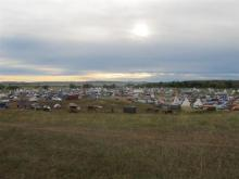 "More than a thousand people gather at an encampment near North Dakota's Standing Rock Sioux reservation on Friday, Sept. 9, 2016. The Standing Rock Sioux tribe's attempt to halt construction of an oil pipeline near its North Dakota reservation failed in federal court Friday, but three government agencies asked the pipeline company to ""voluntarily pause"" work on a segment that tribal officials say holds sacred artifacts. (AP Photo/James MacPherson)"