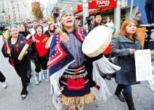 A coalition of First Nations groups march in Vancouver on Dec. 2, 2010 to protest Enbridge's proposed Northern Gateway pipeline