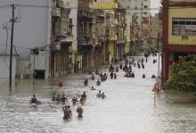 People wade through a flooded street in Havana, Cuba, on September 10 after the passage of Hurricane Irma. Photo: Ramon Espinosa/AP