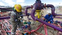 Hydraulic fracturing involves pumping water and chemicals deep into the earth to fracture shale rock beds and release natural gas for extraction.