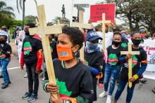 A Global Climate Strike march makes its way through Durban, South Africa, October 2020. (Darren Stewart / Gallo Images via Getty Images)
