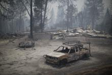 A burned truck and structures are seen in the wake of the Butte Fire, which burned over 70,000 acres, on September 13, 2015, near San Andreas, California. DAVID MCNEW / GETTY IMAGES