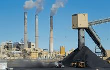 A truck delivers coal to Pacificorp's 1440 megawatt coal fired power plant on October 9, 2017 in Castle Dale, Utah. George Frey / Getty