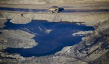 A dump truck drives through the Suncor Energy Inc. oil sands mine in this aerial photograph taken near Fort McMurray, Alberta, in 2015.  (BLOOMBERG VIA GETTY IMAGES)
