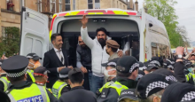 Two refugees were released by immigration enforcement agents Thursday evening after about 200 local residents held an impromptu protest as the men were loaded into a van. (Photo: @KimJohnsonMP/Twitter)