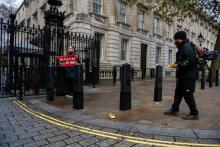 Greenpeace activists drove remote-control electric toy cars under the security gates of Downing Street