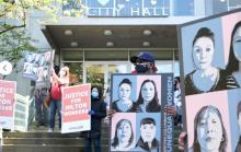 Locked-out Hilton Metrotown workers staged a rally at Burnaby city hall on Monday.Michael Y.C. Tseng