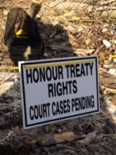 Honour treaty rights sign - Peace River