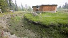 Houses like this one near Fairbanks have collapsed because of permafrost melt - Science Photo Library