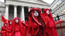 Activists dressed in red demonstrate outside the Royal Exchange in the City of London as part of a wave of protests by Extinction Rebellion in October © Isabel Infantes/AFP/Getty