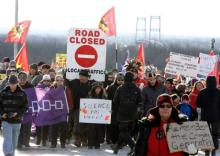 First Nations Idle No More protestors march and block the International Bridge between the Canada and U.S. border near Cornwall Ontario, Saturday January 5 2013., THE CANADIAN PRESS/Fred Chartrand/File