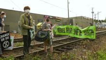 Protesters from the group Extinction Rebellion block the railway tracks in East Vancouver on Sept. 21, 2020.