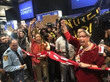 UN security struggles to control an unprecedented protest inside the climate negotiations. Dec. 11, 2019. Photo National Observer