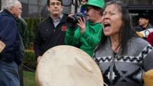 An Indigenous protester demonstrates outside the National Energy Board hearings for Kinder Morgan's Trans Mountain expansion project in Burnaby, B.C. on Jan. 19, 2016. Photo by Elizabeth McSheffrey.