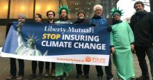 "Activists with Insure Our Future gathered outside Liberty Mutual's Boston and Seattle offices in December 2019 to demand the insure company ""take bold action in the face of the climate emergency and stop insuring fossil fuels."" (Photo: Insure Our Future/Twitter)"
