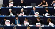"""Members of the European Parliament hold posters reading """"Stop ISDS"""" (investor-state dispute settlement) as they take part in a voting session on February 13, 2019 in Strasbourg, France. (Photo: Frederick Florin/AFP via Getty Images)"""