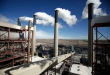 Steam rises from the stacks of the coal-fired Jim Bridger Power Plant outside Point of the Rocks, Wyo., in 2014. Credit Jim Urquhart/Reuters