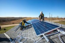 Fossil fuel industry and Indigenous community workers from the Louis Bull Tribe install solar panels in 2017 at the Louis Bull daycare project. Photo by Joan Sullivan / Iron and Earth
