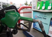 A car is fuelled up at a gas station in Vancouver, on Wednesday, July 17, 2019. File photo by The Canadian Press/Jonathan Hayward