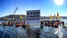 A group of kayaktivists gather before heading to a construction barge in Vancouver harbour near Kinder Morgan's Westridge Marine Terminal on Oct. 28, 2017. File photo by Zack Embree