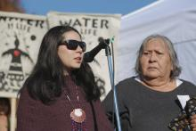 Ocean Hyland (left) and elder Ta'ah (Amy George) of the Tsleil-Waututh Nation address the crowd, Oct. 28, 2017. Photo by Zack Embree