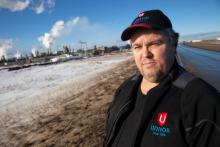 Unifor local president Ken Smith near the Syncrude oil sands operations north of Fort McMurray in March. Photo by Mychaylo Prystupa.