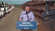 Alberta Premier Jason Kenney with pipe destined for the Keystone XL pipeline, July 3, 2020. Photo by Government of Alberta
