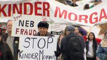 Grand Chief Stewart Phillip of the Union of B.C. Indian Chiefs leads a protest against expansion of the Kinder Morgan Trans Mountain pipeline on Jan. 19, while National Energy Board hearings continue in Burnaby. (CBC)