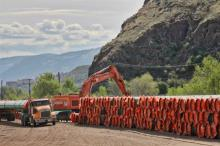Pipe for Kinder Morgan's planned Trans Mountain pipeline expansion is piled high on Mission Flats Road in Kamloops. Photograph By DAVE EAGLES