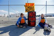 RICHMOND – Police arrested two protesters blocking a gate at the Kinder Morgan Terminal in Richmond on Monday morning, during a demonstration against the company's planned expansion of the Trans Mountain Tar Sands Pipeline in Canada.  After the arrests at about 10 a.m., two other gates were still blocked at the facility on Canal Boulevard, but police said they would not be taking any others into custody.  Early Monday, about a dozen protesters had secured themselves to oil barrels and had 12-foot-long mock