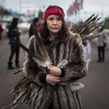 Kumgayaz Dennis, a Dakelh woman from the Lheidli T'enneh First Nation carries wood to be burned in a sacred fire in support of the Wet'suwet'en Nation protest against a BC natural gas pipeline. Photograph The Canadian Press - Darryl Dyck