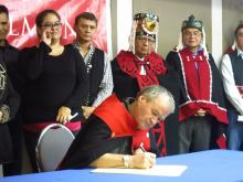 'Support to stop this LNG project is overwhelming,' says Hereditary Chief Yahaan, first to sign the declaration. Photo: Friends of Wild Salmon.
