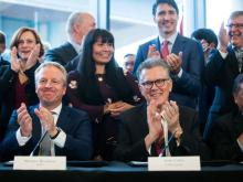 Shell Integrated Gas & New Energies Director Maarten Wetselaar, front left, LNG Canada CEO Andy Calitz, front right, and Prime Minister Justin Trudeau, back right, applaud after a final investment declaration was signed by LNG Canada joint venture participants to build an LNG export facility in Kitimat, during a news conference in Vancouver on Tuesday, Oct. 2, 2018. DARRYL DYCK / THE CANADIAN PRESS