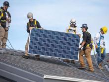 Members of Louis Bull Tribe and Iron & Earth collaborate on a solar installation project - Green Energy Futures/DSF