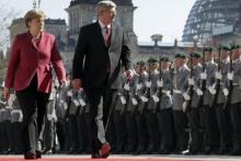 German Chancellor Angela Merkel, left, and Prime Minister Stephen Harper didn't publicly address the question of Canada's ability to fill a resource gap that could follow reduced European trade with Russia.