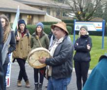 Musqueam singer outside UBC RCMP station