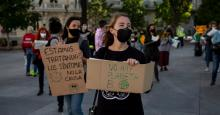 """Activists hold signs reading """"We Are Treating the Symptoms, Not the Cause"""" and """"There Is No Planet B"""" during a climate justice demonstration outside the Spanish Parliament on September 25, 2020 in Madrid. (Photo: Pablo Blazquez Dominguez via Getty Images)"""