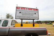 Photo of an anti-Site C Dam sign seen at the annual Paddle for the Peace event. Photo by Wilderness Committee.