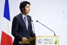 "Canadian Prime Minister Justin Trudeau delivers a speech delivers a speech during the opening day of the World Climate Change Conference 2015 (COP21), on November 30, 2015 at Le Bourget, on the outskirts of the French capital Paris. World leaders opened an historic summit in the French capital with ""the hope of all of humanity"" laid on their shoulders as they sought a deal to tame calamitous climate change. Photograph by: ALAIN JOCARD , AFP/Getty Images"